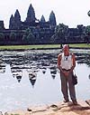 a photograph Willard Van De Bogart in front of Angkkor Wat